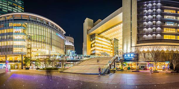 Bright lights shopping malls city plaza nightlife Osaka panorama Japan stock photo