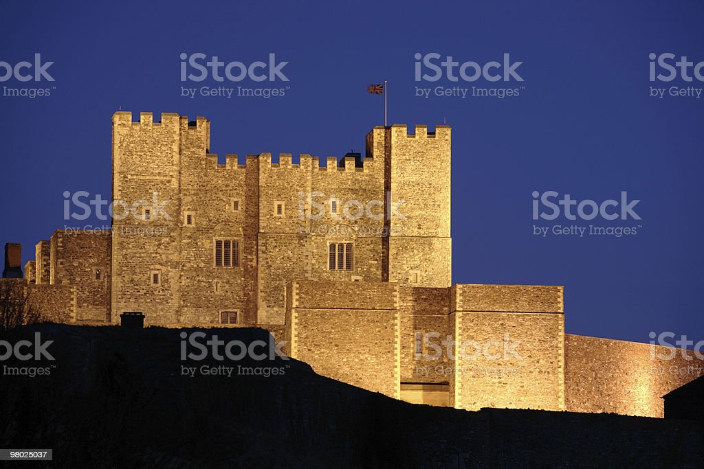 Bright lit Dover Castle in England at night royalty-free stock photo