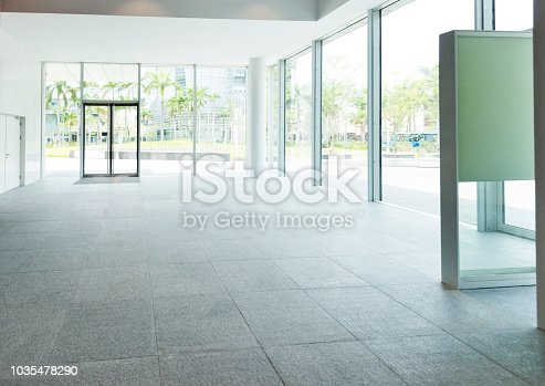 1035478670 istock photo Bright lobby in morden office building 1035478290