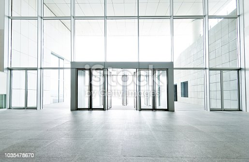 1035478670 istock photo Bright lobby in morden office building 1035478670