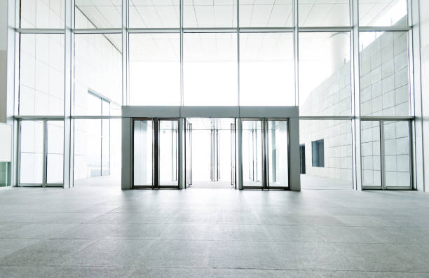 bright lobby in morden office building - entrance stock pictures, royalty-free photos & images