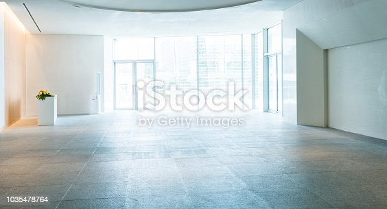 1035478670 istock photo Bright lobby in morden office building 1035478764