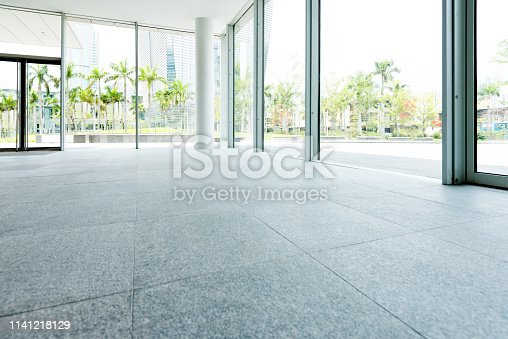 1035478670 istock photo Bright lobby in morden office building 1141218129