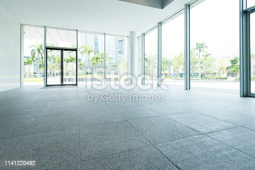 1035478670 istock photo Bright lobby in morden office building 1141220492