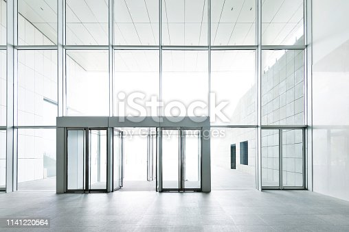 1035478670 istock photo Bright lobby in morden office building 1141220564