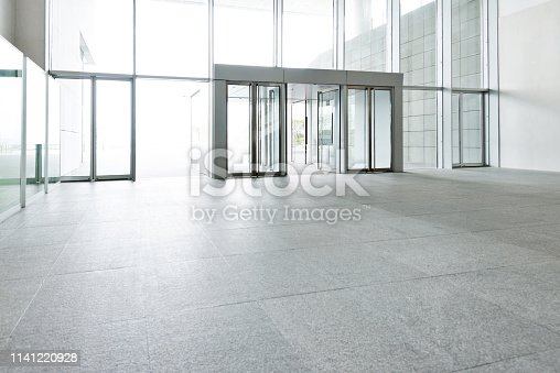 1035478670 istock photo Bright lobby in morden office building 1141220928