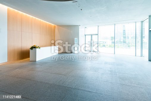 1035478670 istock photo Bright lobby in morden office building 1141221483