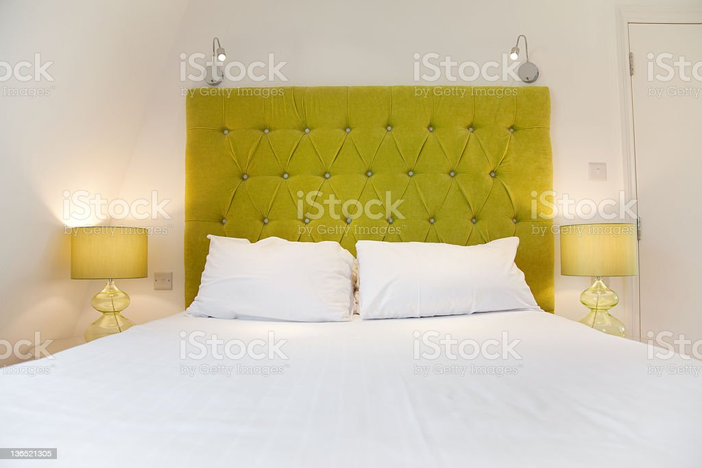Bright luxurious bed design stock photo
