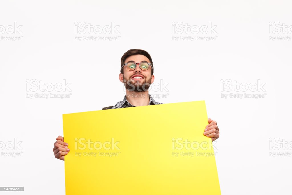 Bright man with yellow placard stock photo