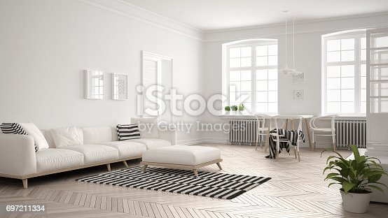 istock Bright minimalist living room with sofa and dining table, scandinavian white interior design 697211334