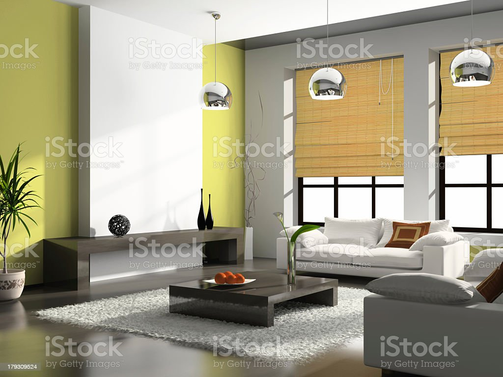 A bright modern furnished apartment with a green accent wall stock photo