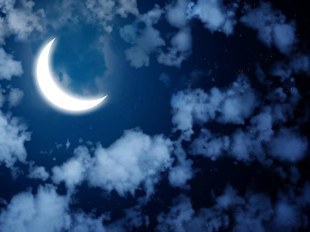 Bright moon in the night sky stock photo