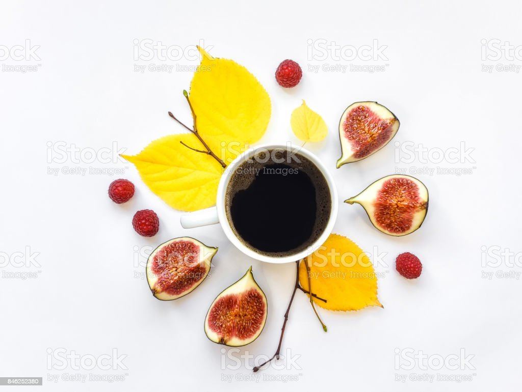 Bright morning cup of coffee with fig fruits and raspberries. Autumn decoration. Flat lay, top view