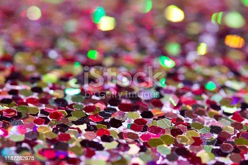 1134278444 istock photo Bright multi color confetti glitter texture background with bokeh 1187262675