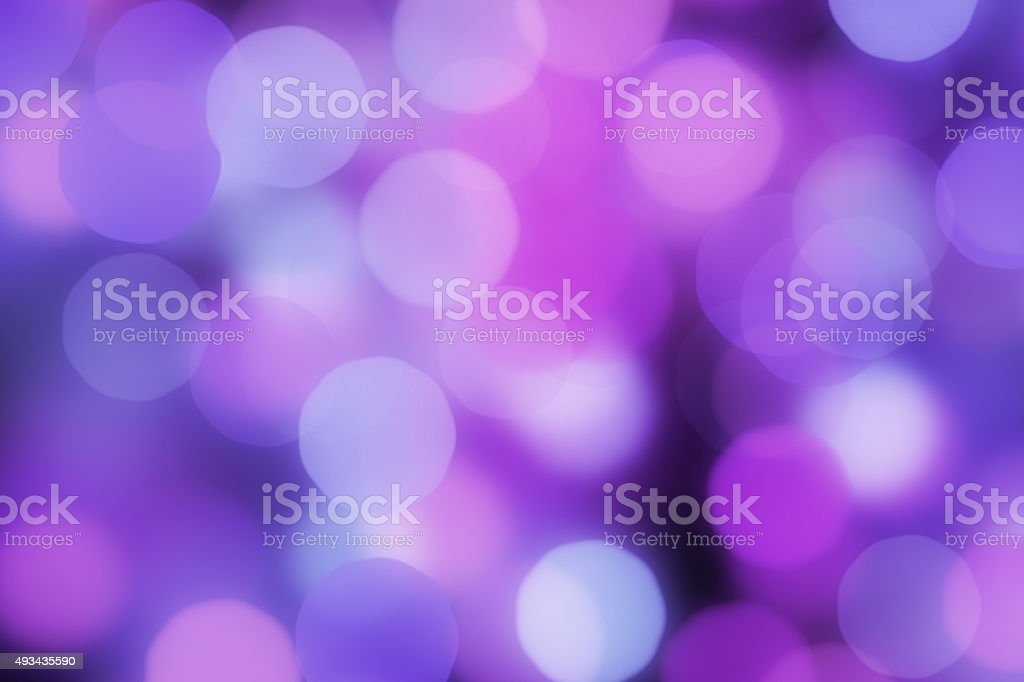 Bright multicolor blurred bokeh dots on black background stock photo
