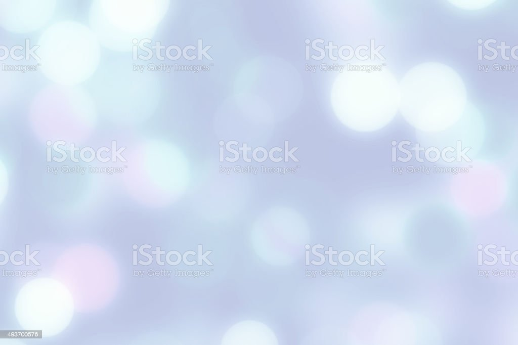 Bright multicolor blurred bokeh dots on light background stock photo