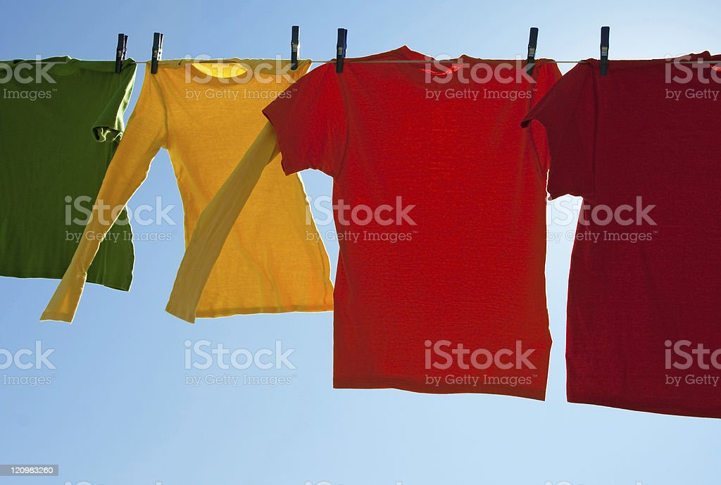 Bright multi-colored clothes drying in the wind royalty-free stock photo
