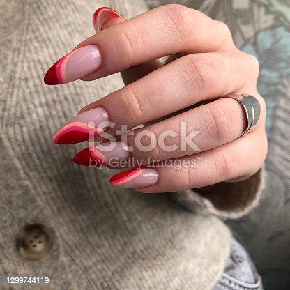 istock Bright multi-colored design of manicure.Multicolored manicure close up 1299744119
