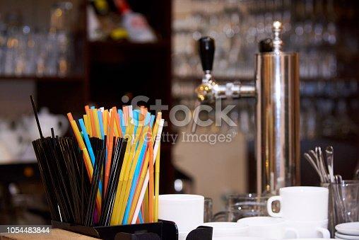 Bright multicolored straws on the bar.
