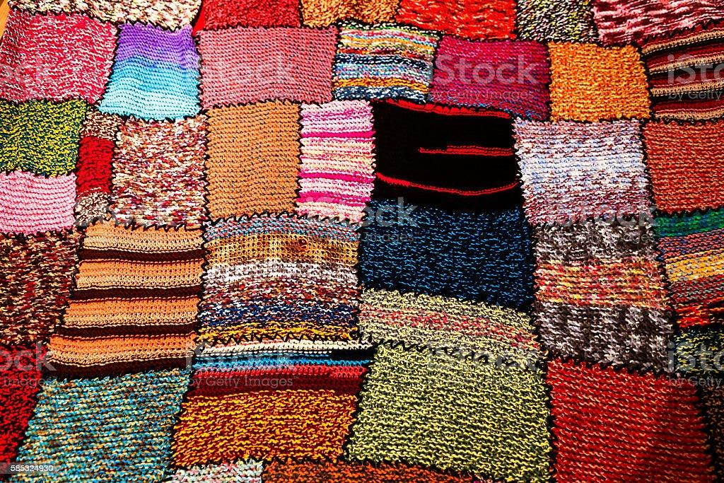 Bright multi-coloured handmade patchwork blanket stock photo