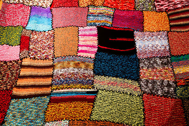 bright multi-coloured handmade patchwork blanket - quilt stock photos and pictures