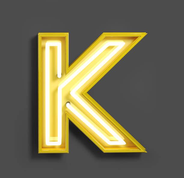 bright neon font with fluorescent yellow tubes. letter k. - буква k стоковые фото и изображения