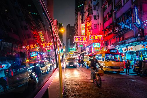 Bright neon signs colourful crowded cityscape Mongkok, Kowloon, Hong Kong China