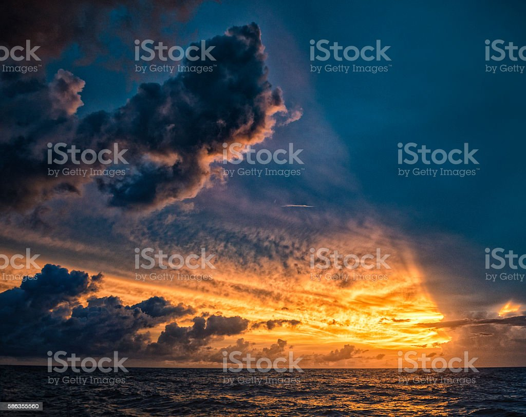 Bright Ocean Sunset with Red Clouds stock photo