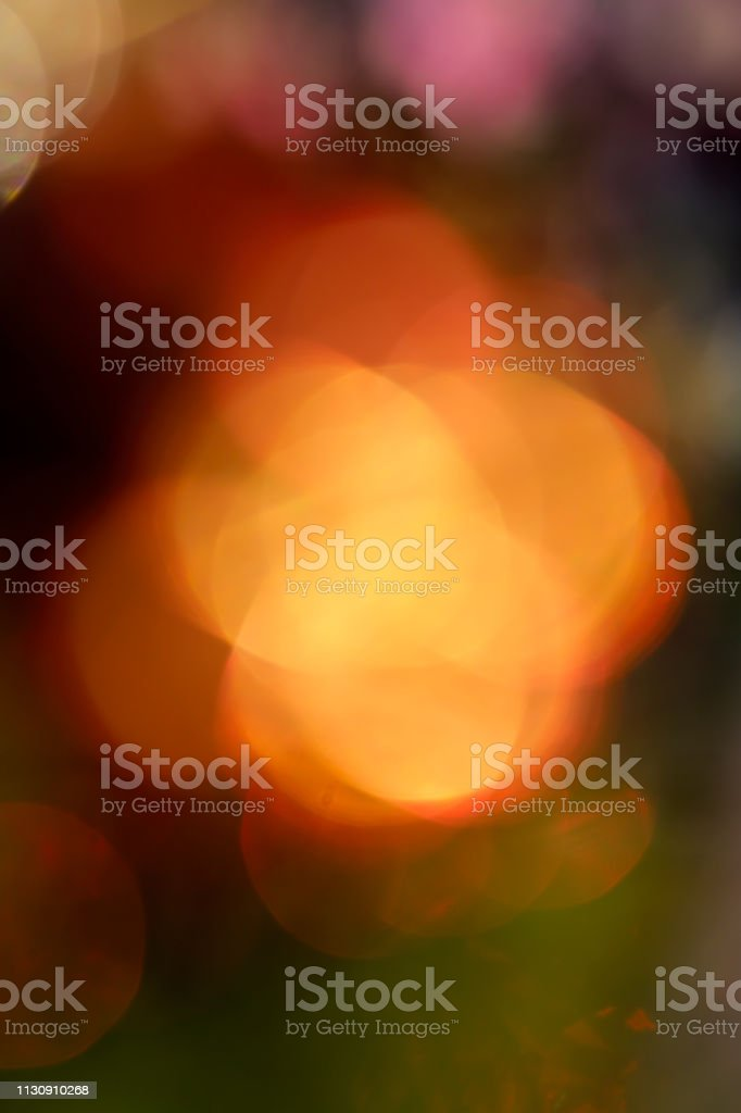 Bright orange amber out of focus bokeh background stock photo