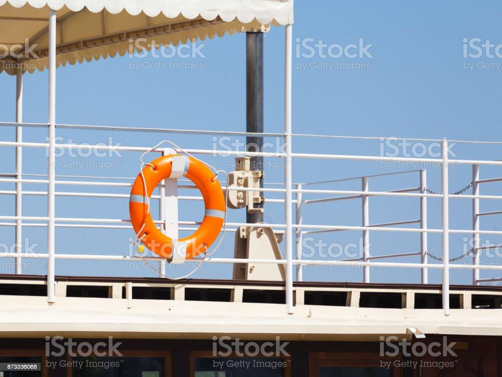 Bright orange lifebuoy stock photo