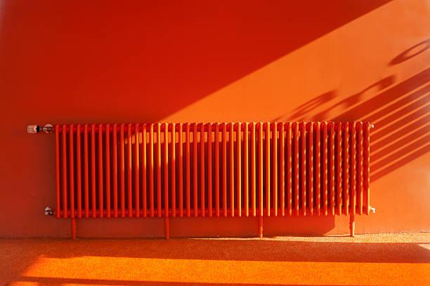 Bright orange room with orange walls, floors, and radiator foto