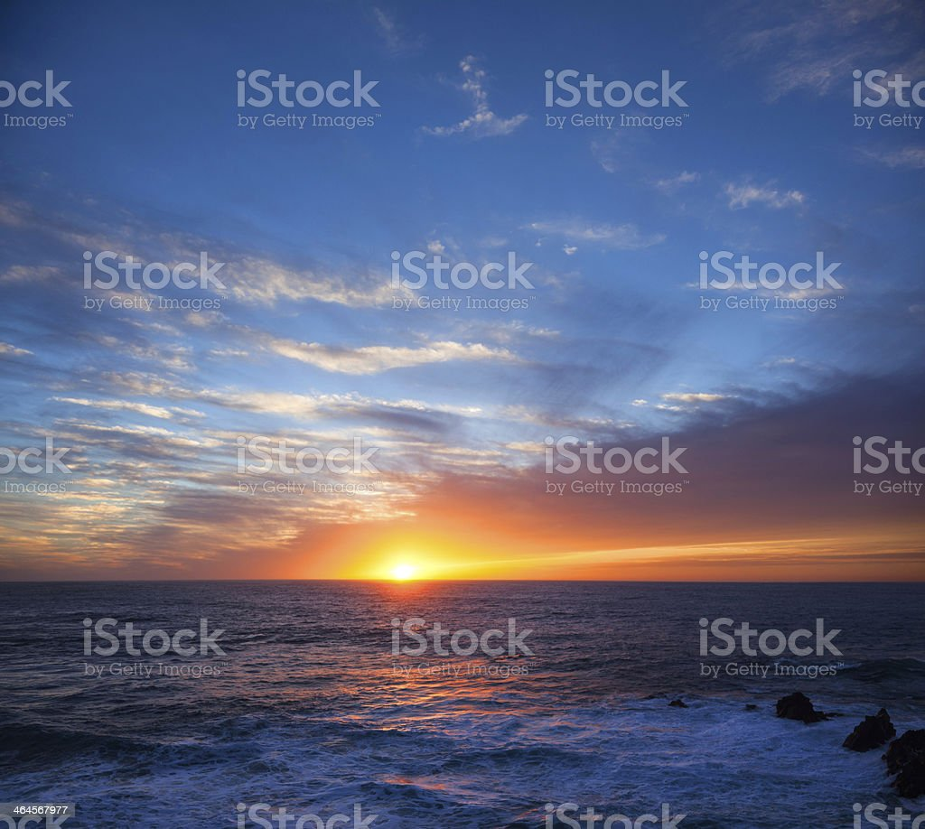 Bright orange sunset over sea horizon stock photo