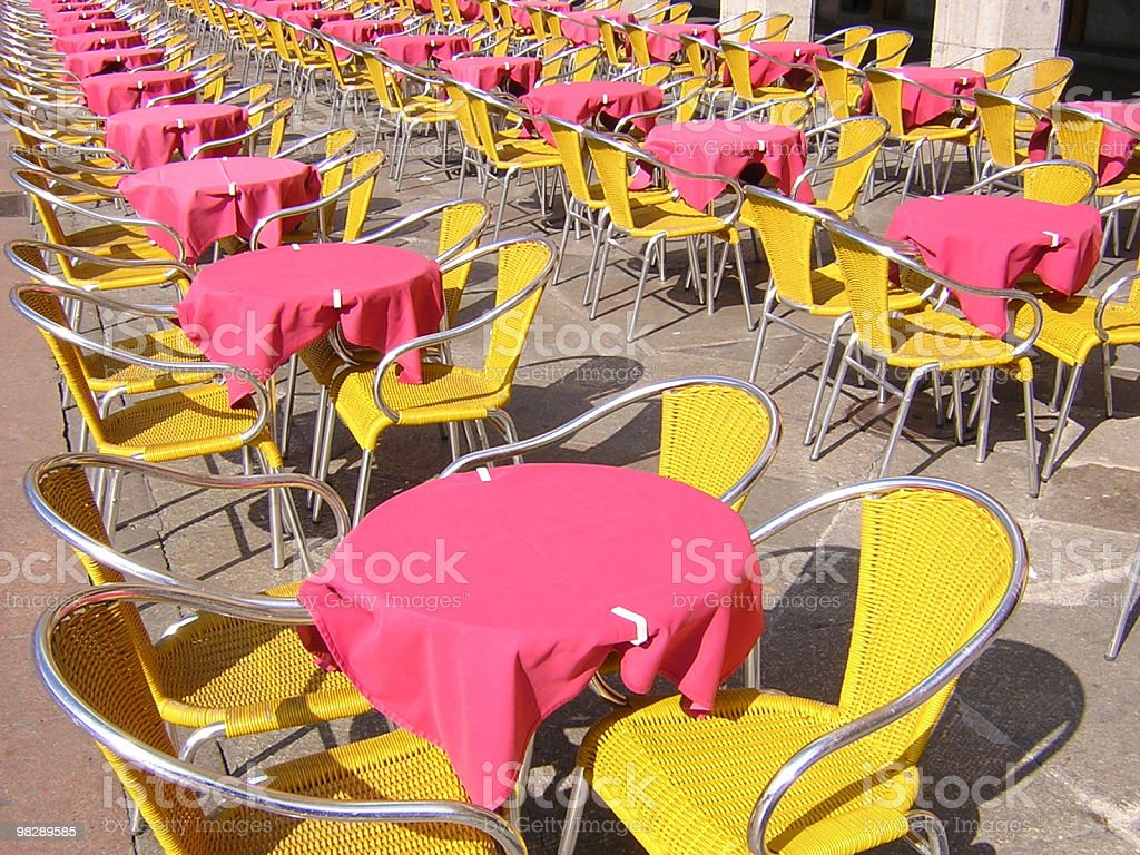 Bright Outdoor Cafe Tables and Chairs royalty-free stock photo