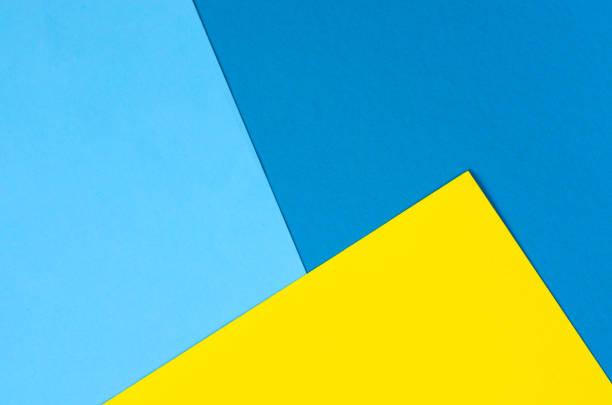 fondo de papel brillante de varios colores. - amarillo color fotografías e imágenes de stock