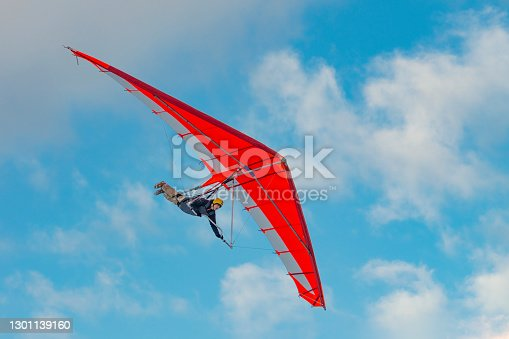 istock Bright paraglider wing in the sky. Extreme sports 1301139160