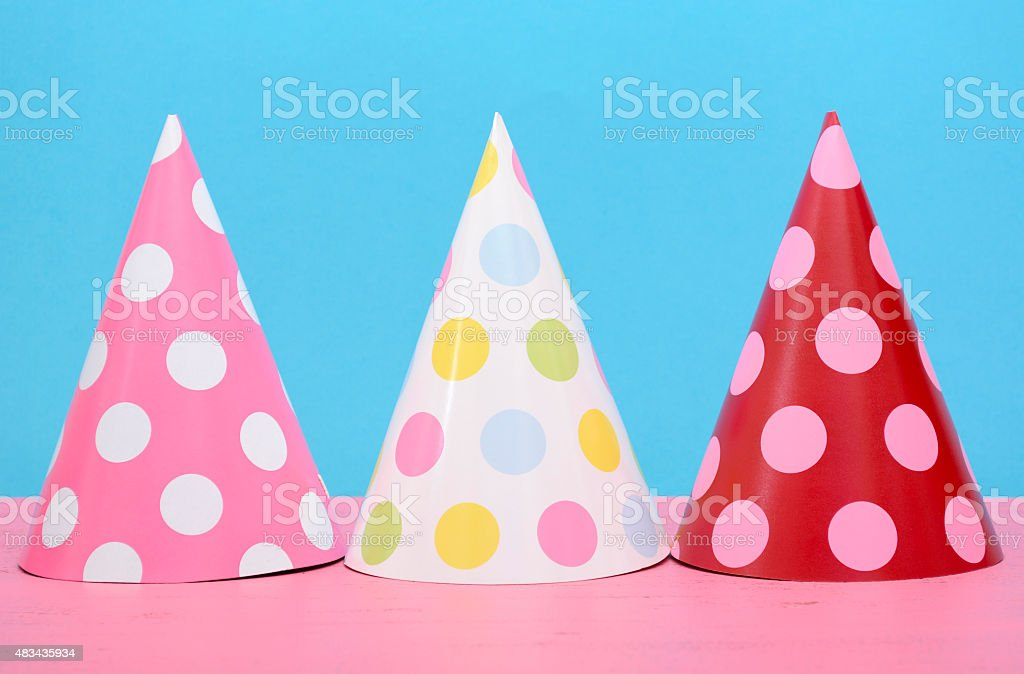 Bright party polka dot party hats stock photo