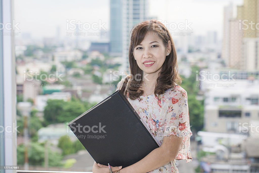 bright picture of pensive woman in office royalty-free stock photo