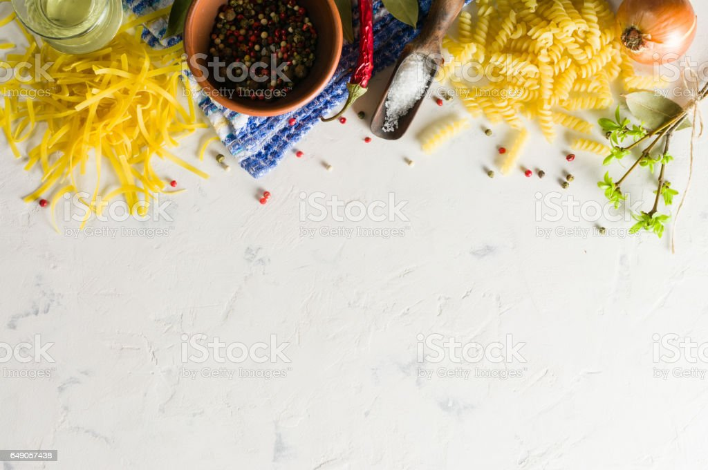 Bright picture with different varieties of pasta. Spices and seasonings for cooking. stock photo