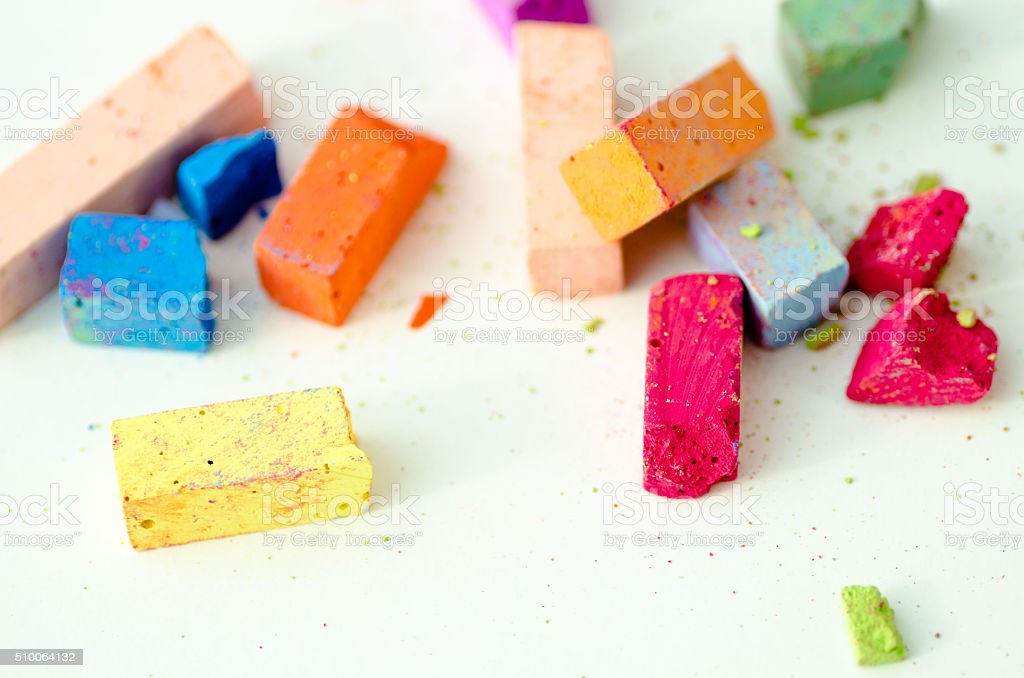 Bright pieces of chalk on white background stock photo