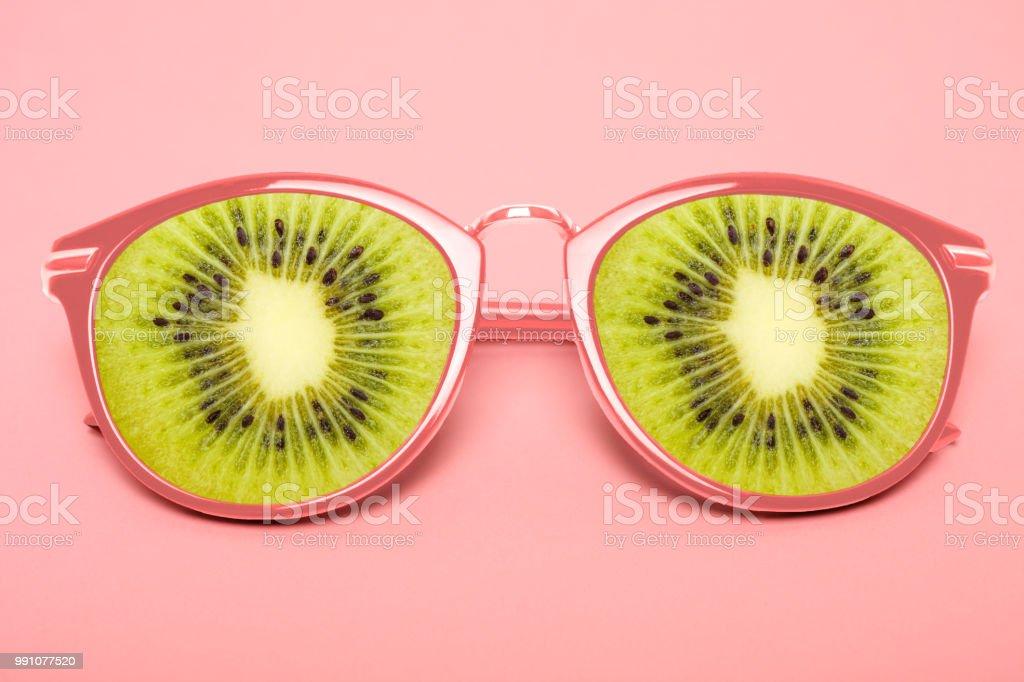 Bright pink sunglasses with kiwi stock photo