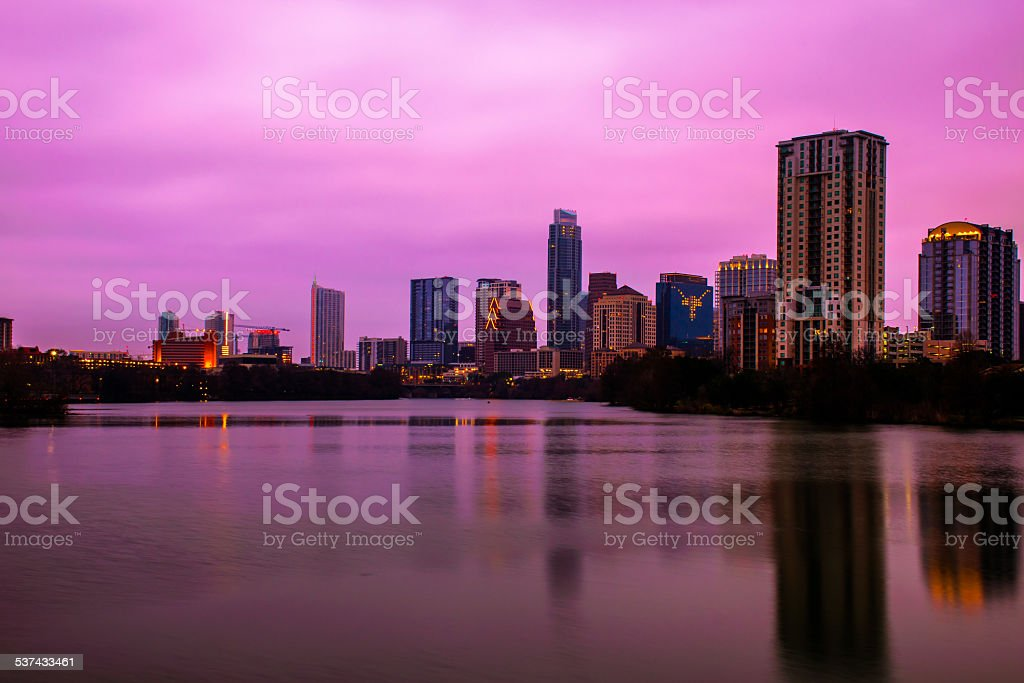 Bright Pink Sunrise Austin Skyline River Side Pedestrian Bridge stock photo