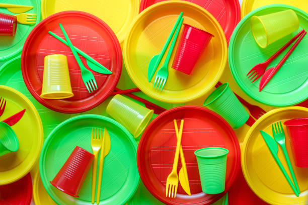 Bright plastic disposable tableware background Bright plastic disposable tableware background disposable stock pictures, royalty-free photos & images