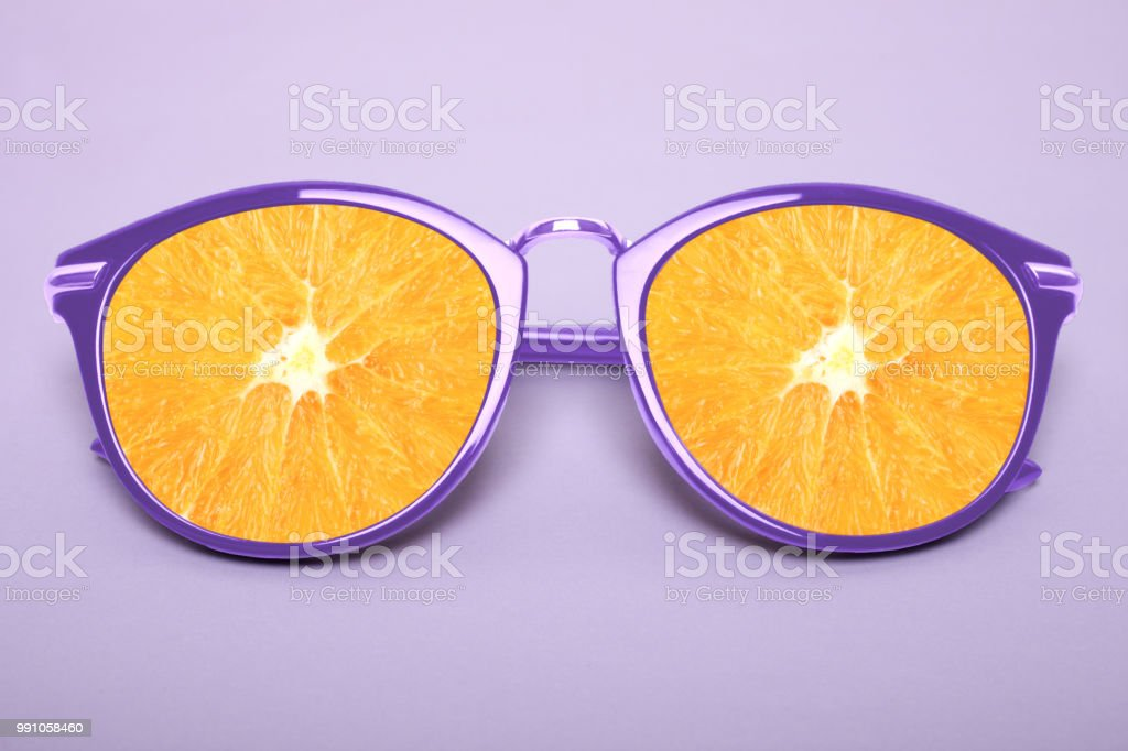 Bright purple sunglasses with orange stock photo
