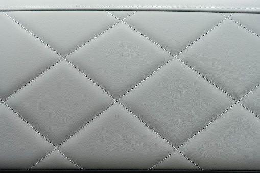 Bright quilted leather in a car interior.