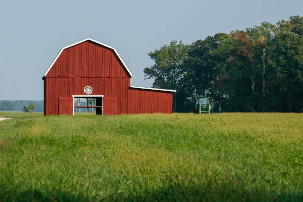 Bright red barn in a field in Eastern Maryland stock photo