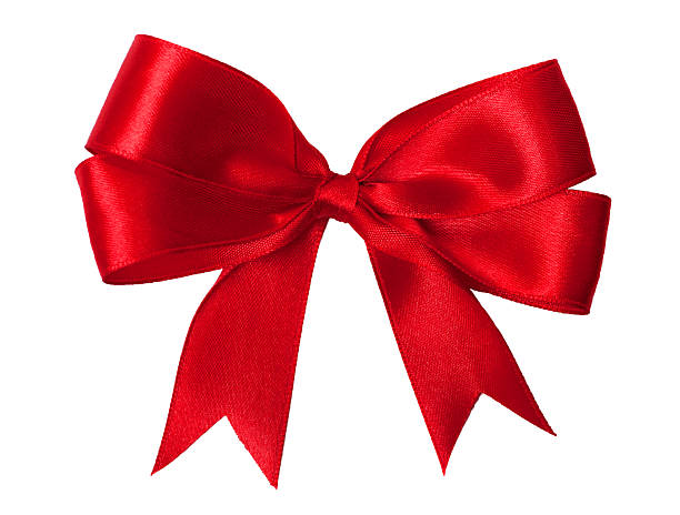 bright red bow - ribbon sewing item stock photos and pictures