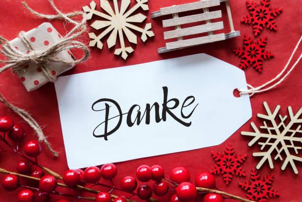 Leuchtend rote Weihnachtsdekoration, Label, Danke bedeutet Danke – Foto