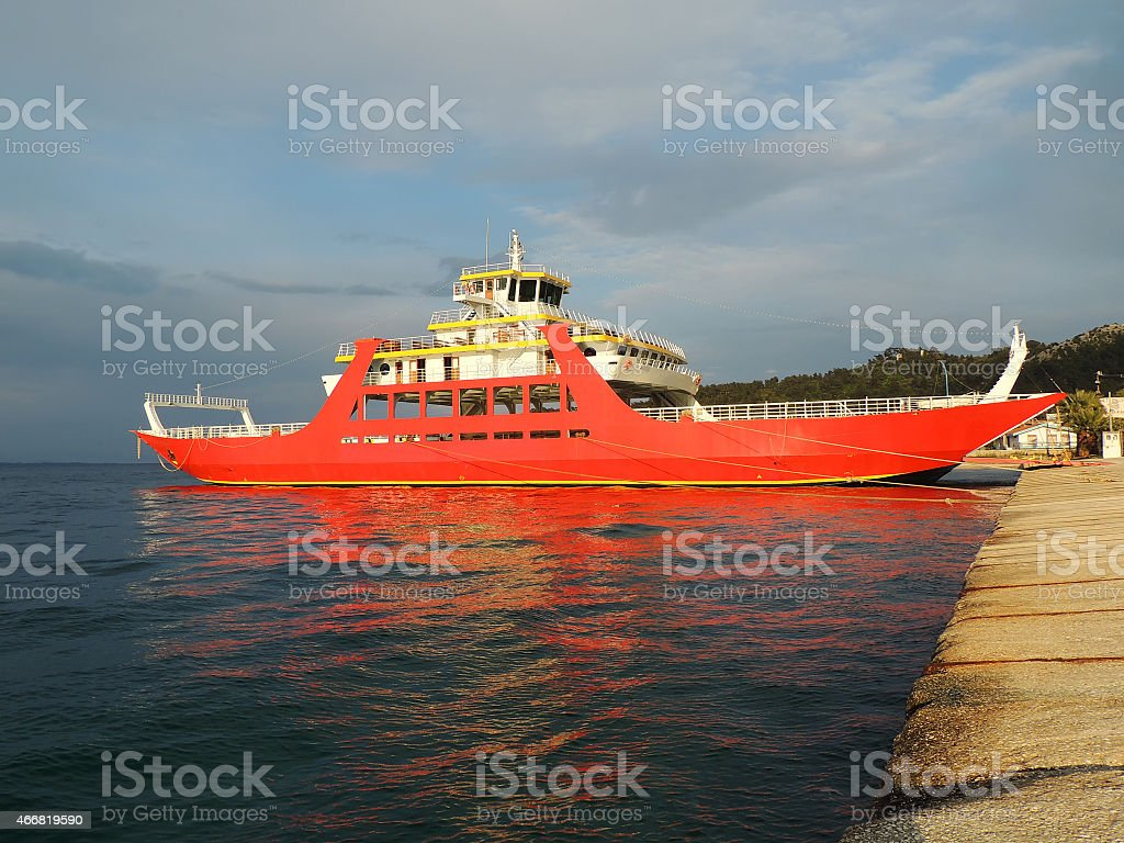 Bright Red Ferryboat On The Ferry Terminal stock photo