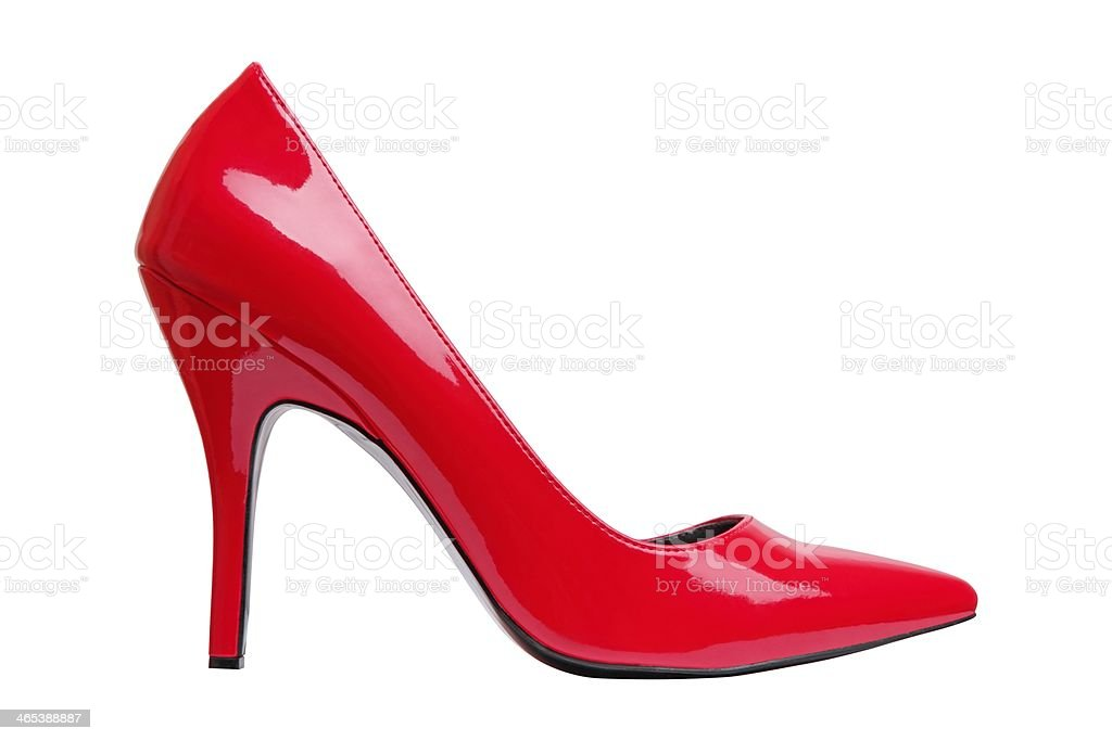 A bright red high heel woman's shoe by itself  stock photo