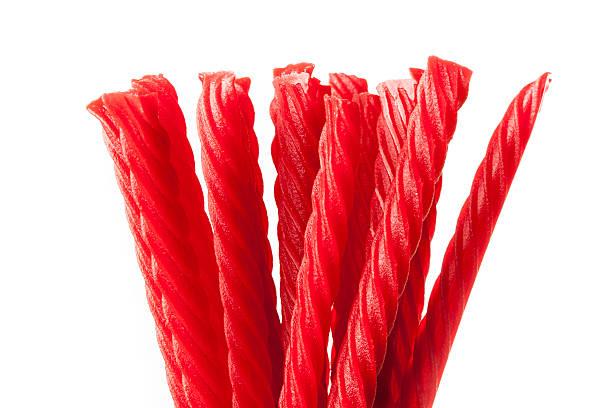 rosso brillante caramella di liquirizia - liquirizia foto e immagini stock